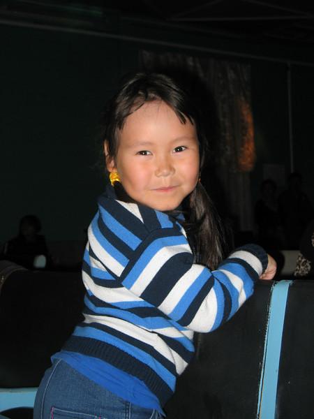 Young Nenets girl enjoying the helicopter ride.
