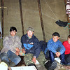 Nenets boys inside their chum. Reindeer cooperative. Karatkaya region