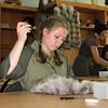 School girl learning to sew fur clothing at the Nar'yan-Mar Boarding School.