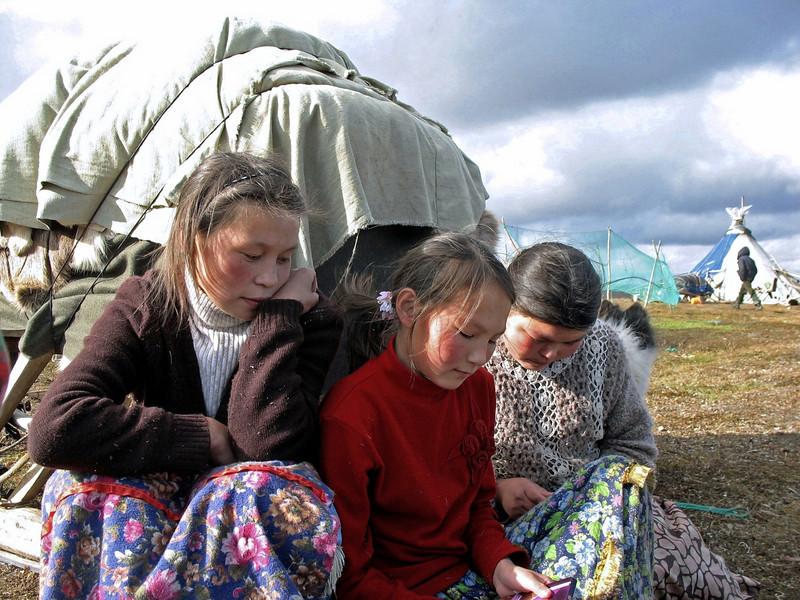 Yamp-to Nenets girls & woman sewing on the tundra.