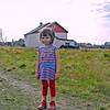 Little Olga, Karatayka village girl. Four years old, she was upset because the knees of her leggings were dirty.