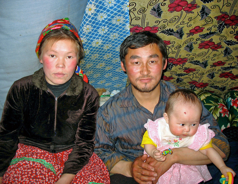 Yamp-to Nenets family portrait. Sveta and Fyodor with their baby girl.