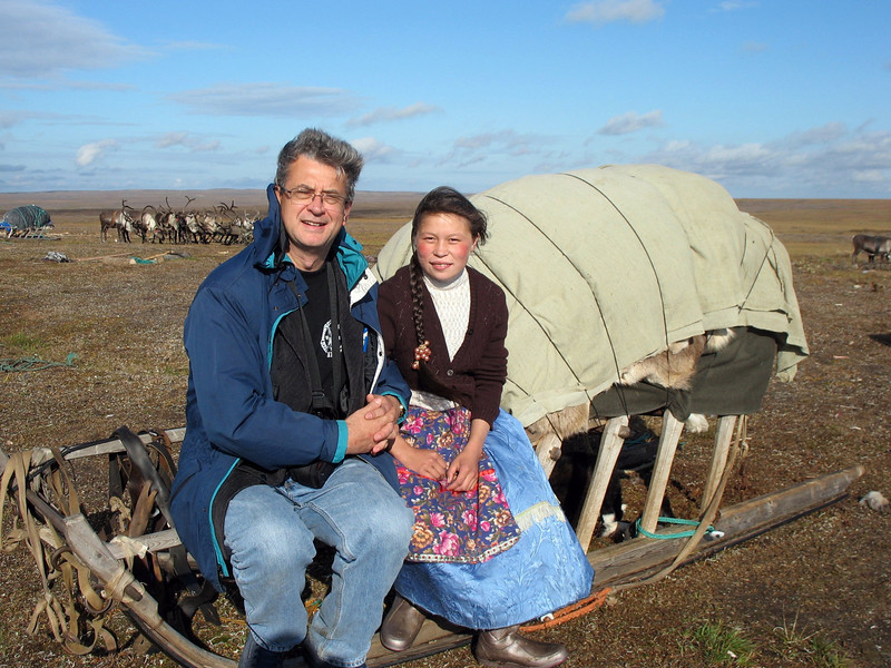 """With Nenets girl, Alla, on the tundra. I asked if I could hold her arm and she modestly replied, """"Yes, but only for the photo""""."""
