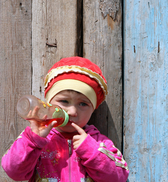 Baby in the Kambileevskoe refugee camp.