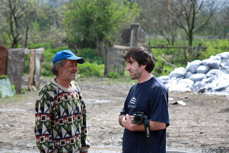 Amir speaking with one of the men at the Kambileevskoe refugee camp.