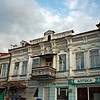Old buildings in Vladikavkaz. The scroll work balcony is typical for this region.