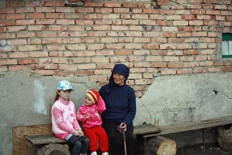 Grandmother with her grandchildren in a refugee camp.