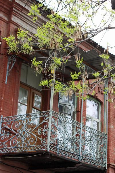 Scrolled metal balcony in Vladikavkaz.