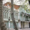 Old Russian architecture through the trees in Vladikavkaz.