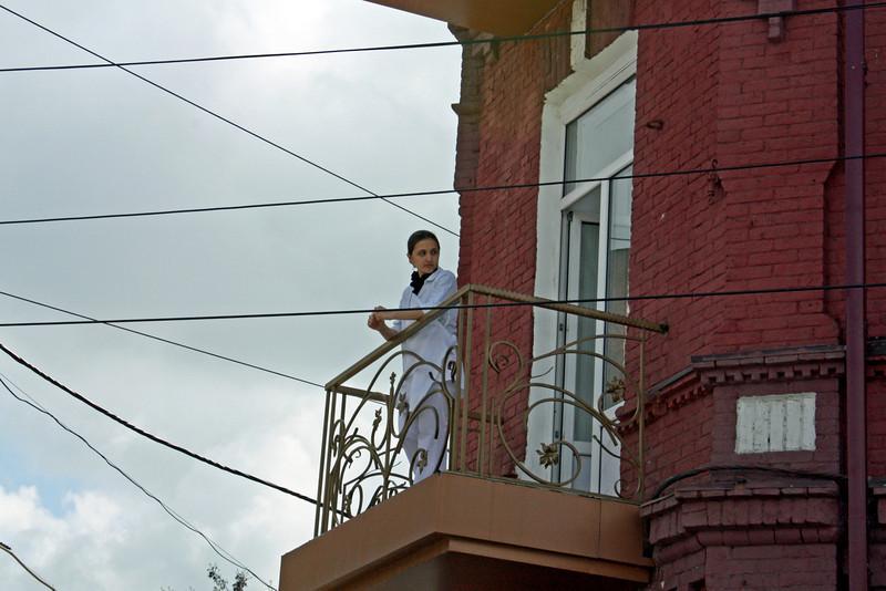 Girl on balcony.