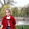 Girl eating an orange in the park.
