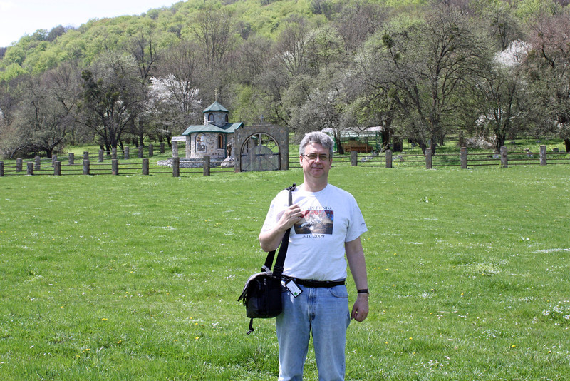 Standing in a pasture near a small chapel.
