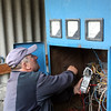 Ahshar Varziev checking the controls of his homemade hydro-power plant.