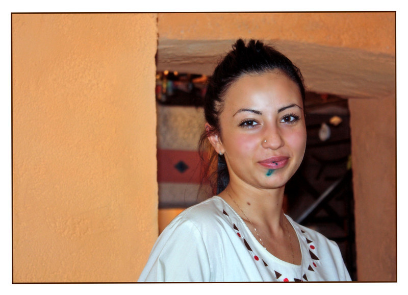 Waitress with 'zelonka' & a diamond in her nose at restaurant Africana in Vladikavkaz.