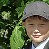 School boy wearing a cap.
