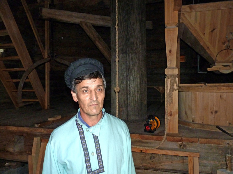 Man dressed in traditional serf clothing on the Tarkhany Estate.