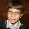 Young graphic arts enthusiast at the Museum of Contemporary Art's Graphics Biennale. Маленький еврейский мальчик Марк, который любит изобразительное искусство на биеннале графики в музее современного искусства в Перми.