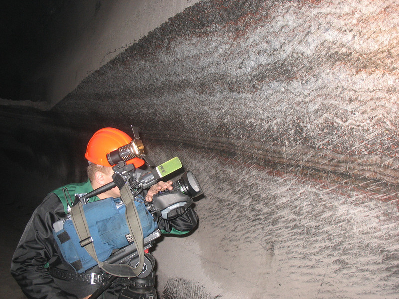 Dima shooting the mine's wall scrapings.