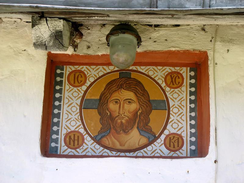 Fresco of Jesus at entrance to 10th century Pskov church.