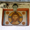 Fresco of Jesus at entrance to 10th century Pskov church.