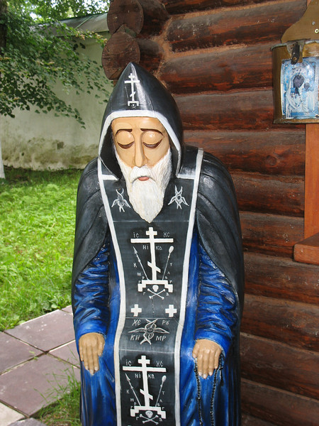 Wooden sculpture at the Mirozh Monastery kiosk.