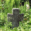 Medieval cross in the grass.