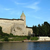 People swimming on the river bank outside the Kremlin walls.