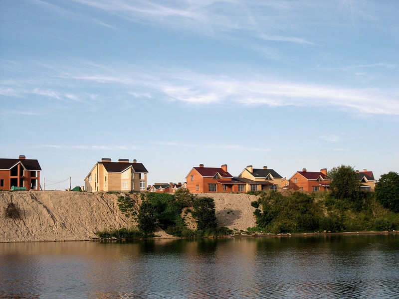 Upscale housing being built on the banks of Pskov's Velikaya River.