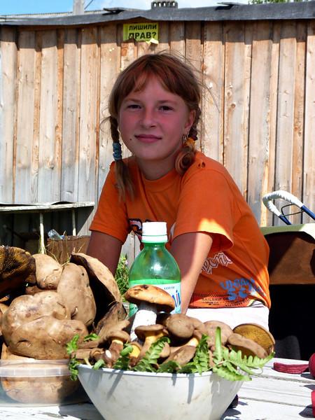 Selling mushrooms.