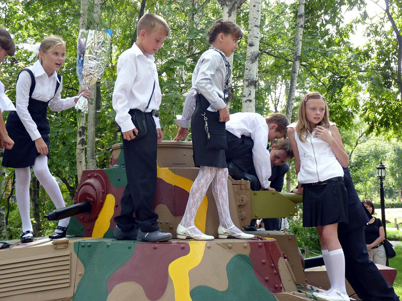 Kids playing on a restored Japanese tank.