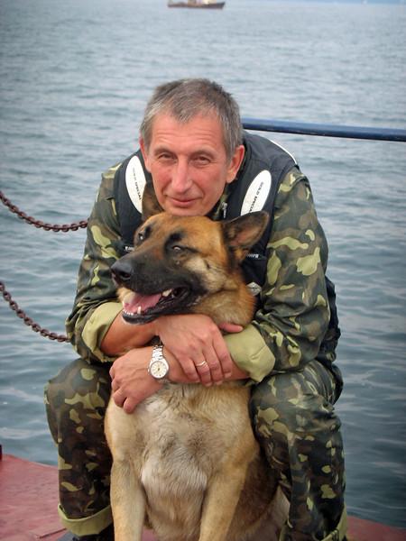 Border Patrol Commander with patrol dog.