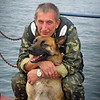 Border Patrol Commander with patrol dog.