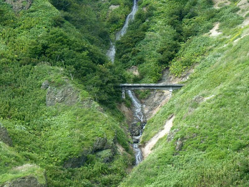 A bridge across the waterfall on Moneron Island.
