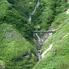 A bridge across the waterfall on Moneron Island.
