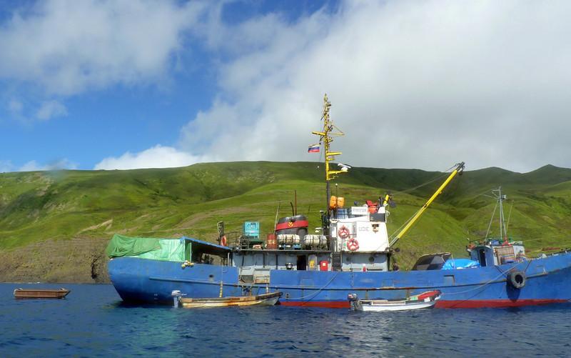 Blue trawler off Moneron Island. (Russian Far East)