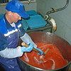 Salting the roe, known as red caviar in Russia.