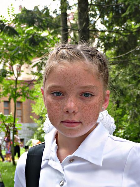 Freckle faced school girl.