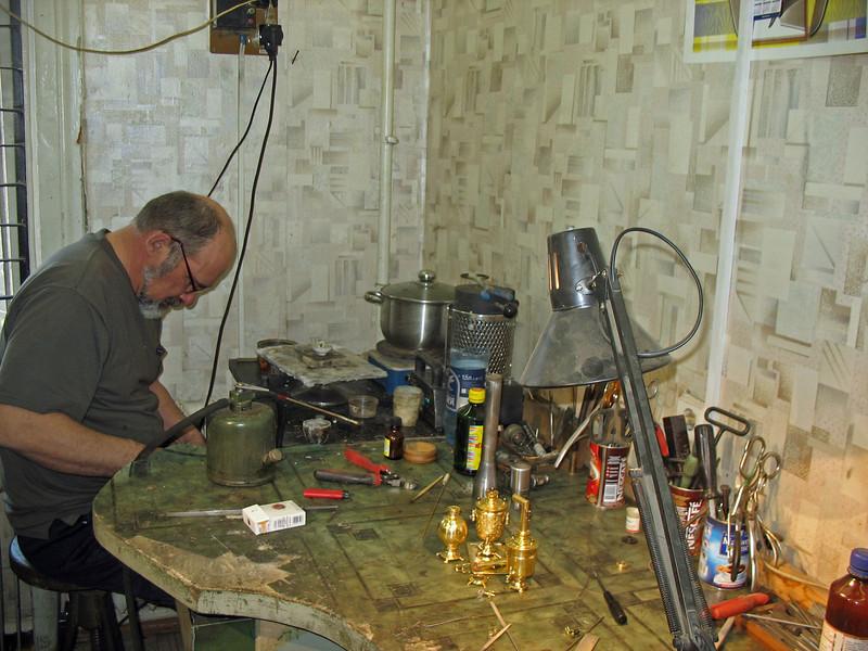Making miniature samovars.