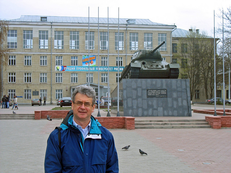 In Tula square with Victory Day banner in the background.