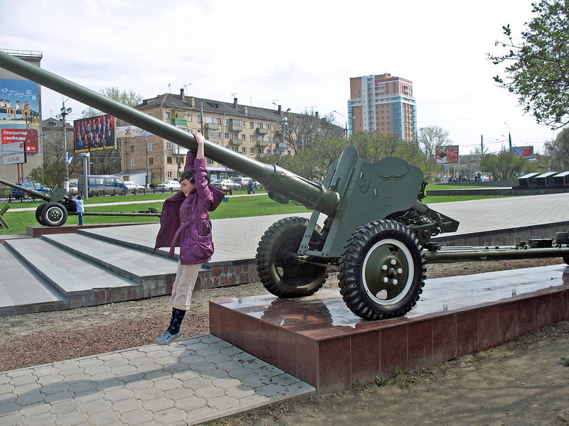 Playing on an anti-aircraft cannon.