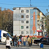 Tula street scene with USSR rocket on the side of an apartment building.