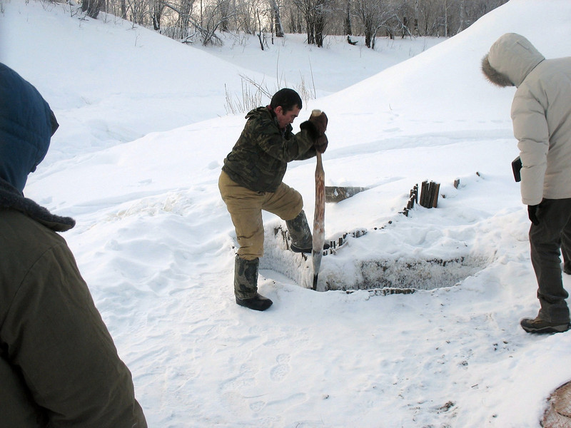 While out, digging a hole for some ice fishing. (Laytamak, Siberia)