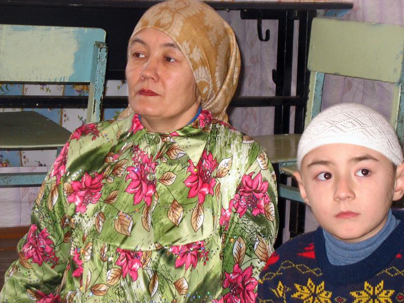 Tatar woman & boy in the mosque. (Laytamak, Siberia, Russia)