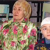 Tatar woman & boy in the mosque. (Laytamak, Siberia, Russia)