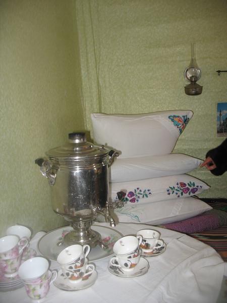 Samovar & embroidered pillows in Eskander's home.