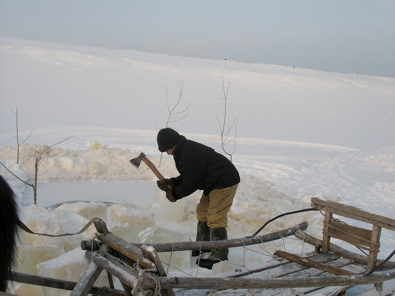 Chopping ice to bring home.
