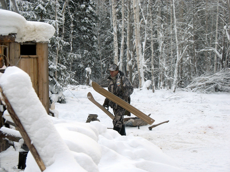Game ranger with skis.
