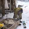 Game ranger preparing his skis.