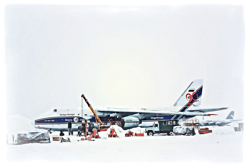 Snow covered plane on the tarmac.