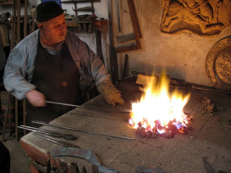 Yuri Borodin, blacksmith & artisan, stoking the flames. (Vladimir, Russia)